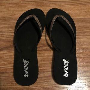 used Reef glitter flip flops. Size 8.